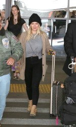 Hilary Duff - Arriving at LAX Airport in Los Angeles 3/9/17