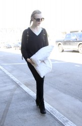 Elle Fanning - At LAX Airport 3/13/17